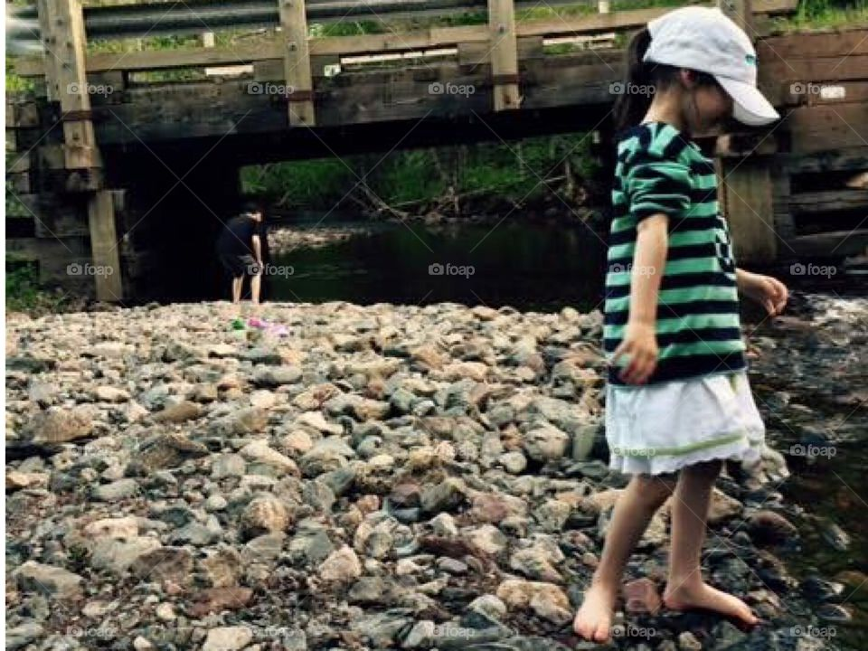 Children dipping toes in the water.
