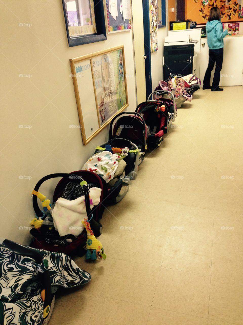 Track Infant Carriers. This daycare scene disturbed me, so I took a picture. This might be part of what is wrong with this world.