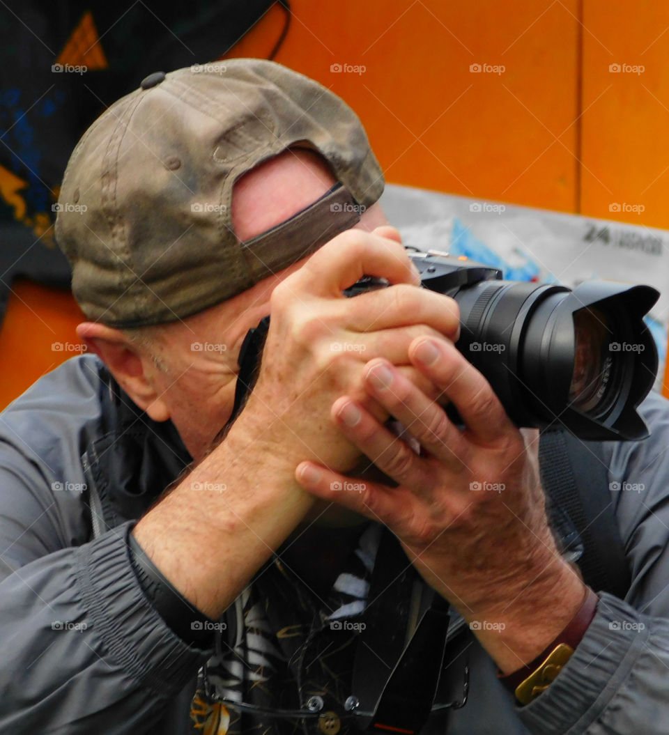 Photographer On landscape shooting assignment!: Working Hands Ip Close!