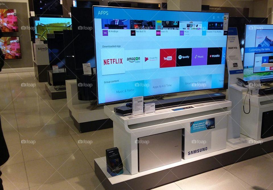 Samsung QLED television 4K Ultra High Definition TV with soundbar and sub-woofer