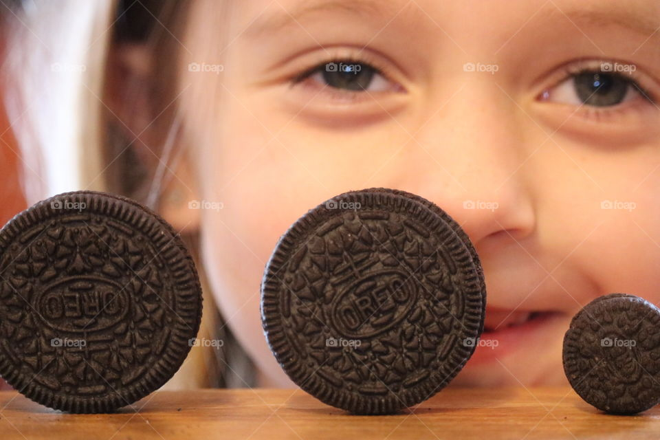 Oreo -Smile for Oreos. This little lady is happy to be eating Oreos.