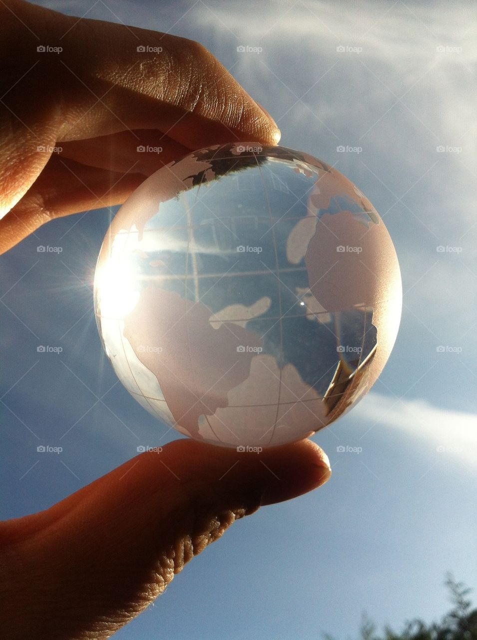 Close-up of person's hand holding glass globe