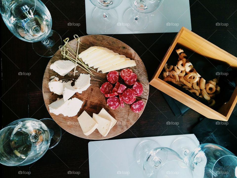 High angle view of cheese slice on table
