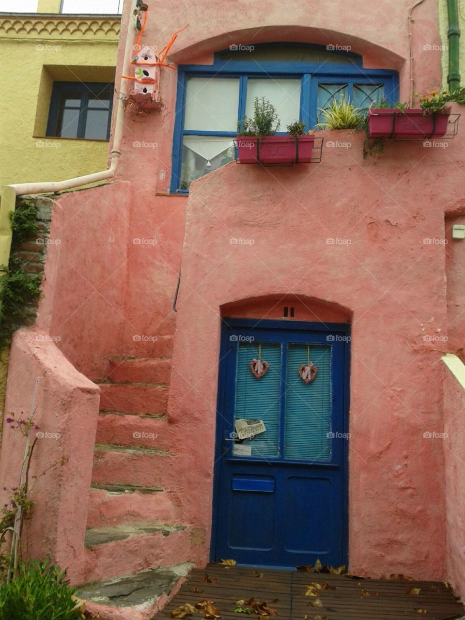 blue door to amazing old colorful house in Spain